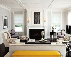 classic contemporary chic.  graphic art, architecture, black, and yellow.  love that ikat ottoman.