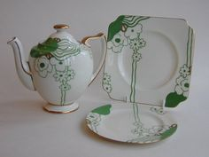 Doulton deco: Glamis tea pot in Fairy shape, cake plate and side plate, V1312, c1933-4 (6,7). Green colourway - stunning green and gold abstract floral design with gold gilt highlights and trim.
