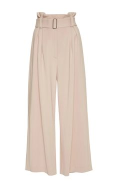 Closet staple experts **A.L.C.** exemplified their knack for fit and flare in these gaucho pants rendered in a pale pink hue. Belted at the waist, they are high rise at calf length.