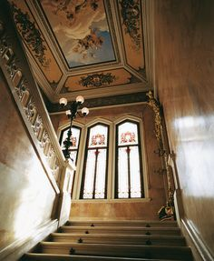 View of grand staircase of Villa Feltrinelli. #lake #garda #grandhotel #villafeltrinelli #staircase #fresco #windows