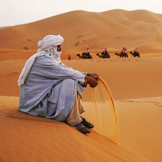 Photo by // A quiet moment in the sands of the Sahara desert for a Moroccan camelier. to see more images of Morocco - - Desert Dream, Desert Life, Desert Sahara, Desert Aesthetic, Deserts Of The World, Desert Colors, Desert Oasis, Desert Fashion, Beauty Around The World