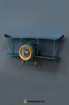 Biplane Blue Loft Wall Clock - The original decor of the interior of an apartment, studio or country house in the loft style is th -