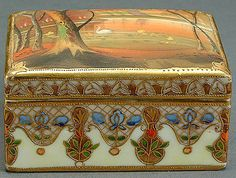 A NIPPON SCENIC DECORATED COVERED PORCELAIN BOX circa 1910 painted with an autumnal setting of a swan in a lake