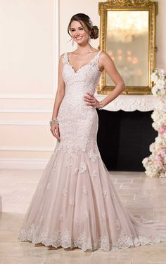 Imagined and handcrafted with simple, yet stunning detail, this feminine fit-and-flare wedding dress from the Stella York bridal gown collections features crystal beaded lace shoulder straps that give way to a plunging neckline and sexy low back.