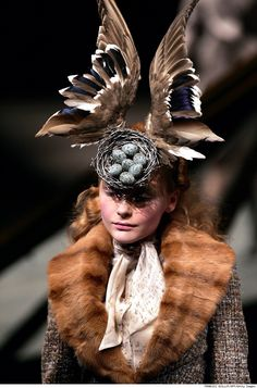 """Alexander McQueen - model doesn't look any too happy.... Probably thinking """"I can't believe I have to wear this stupid hat!"""" Hope the poor girl's not a vegetarian (or vegan!) - omg the horror!!!"""