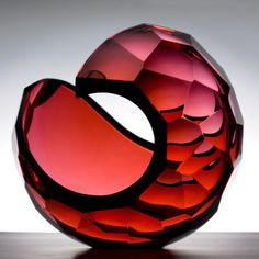 Red Cut Planet by Lena Bergstrom. Unique blown crystal with cut surface. Focus…
