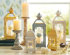 Jeweled lanterns and distressed pillar holders for classic charm