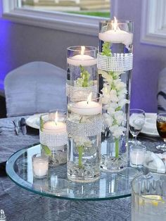 Excellent design centerpiece ideas featuring wedding table centerpiece and clear glass candle holders plus floating flowers and candle table centerpieces. Awesome design of table centerpieces ideas. Floating Candle Centerpieces, Wedding Table Centerpieces, Flower Centerpieces, Reception Decorations, Table Decorations, Centerpiece Ideas, Graduation Centerpiece, Simple Centerpieces, Quinceanera Centerpieces