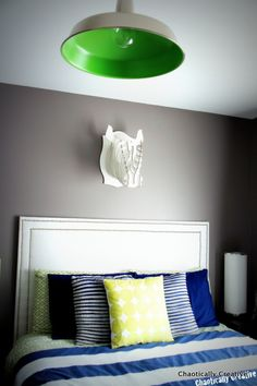 Cool tween boys room dark grey, navy and pops of color- great site gives a breakdown of where everything is purchased and the paint color used