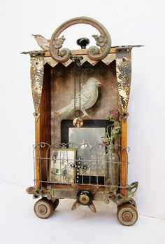 Art assemblage shadow box with wood embellishment pediment, wheels, etc...roadrunner.com