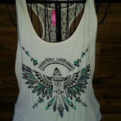 Lg tank with beautiful back detail Cute tribal print tank. Beautiful back detail. Sz lg Tops Tank Tops