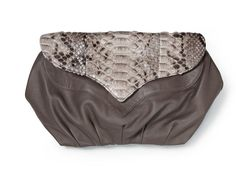 MY cousin's awesome clutch bag, I have it in black and gold - gorgeous.