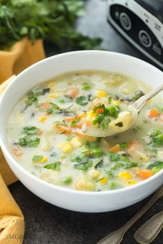 This Slow Cooker Creamy Vegetable Soup is a hearty, healthy meal in one -- made so easy with the crockpot! It's low in calories but BIG in flavor! Video