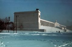 A cool Winter at the Zeppelinfeld in Nürnburg, 1940. This location was specially constructed by Reichsminister of Architecture, Albert Speer, in accordance to Hitler's vision for the 'New Reich' which included designs directly influenced from the building styles used by the Roman Empire. This was known as Neo-Classical. The Zeppelinfeld was primarily used for the biggest and most brilliant NSDAP rallies and still stands today.