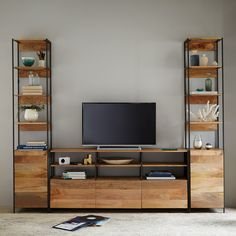 Create your perfect media cabinet with West Elm's Industrial modular system; $2,797. westelm.com