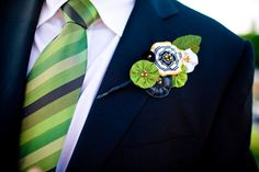 Fabric boutonniere, green and blue tie.