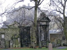 Greyfriars Kirkyard - Edinburgh, Scotland (with Edinburgh Castle in the background)  This is the view J.K. Rowling had from the Elephant House where she wrote much of Harry Potter.  Once you look out the windows, you see where she got it!