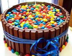 M and Kit Kat Cake!  http://chefpaige.blogspot.com/2009/05/kit-kat-and-m-birthday-cake.html