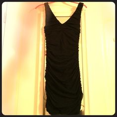 Black Knee-Length Stretch Dress Stretches to fit figure! Very elegant especially because it is knee length! Never been worn! Express Dresses Midi