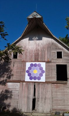 """Kansas Flint Hills Quilt Trail: MARION COUNTY: """"Grandmother's Flower Garden"""" Bill and Cathleen Fish, 894 190th, Hillsboro KS 67063 This historic barn was built by hand in 1916. The Fish Family purchased the 40 acres of the """"Scully ground"""" farmstead in the 1990's."""