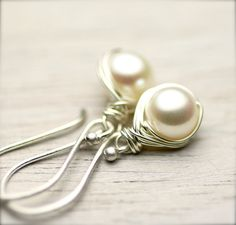 Love those and would like them in any color. White Freshwater Pearls Wire Wrapped Earrings on by PoppyLayne