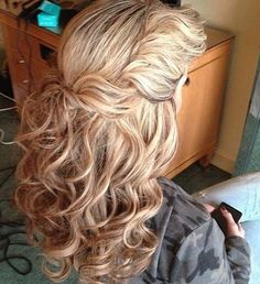 twisted half up curly hairstyle for thick hair