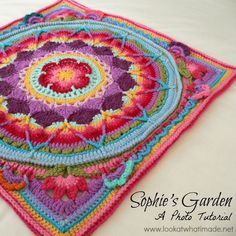 Sophie's Garden is an extension of Sophie's Mandala. It is a large crochet square with lots of floral detail and step-by-step photo tutorials for each part.