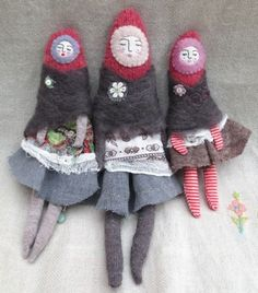 three dolls made from fabric scraps and felted wool