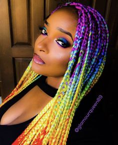 Wooooooah gotta love perfect rainbow locs! Love choosing a darker purple near the roots and the length where it transitions to blue is super flattering for her cheekbones <3