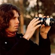 Jim Morrison and with a camera too ! Wonderful image , taken by Linda if I am correct ?