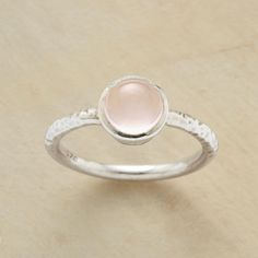 ROSE QUARTZ RING -- The irregularities of hand hammering atop the band accentuate the pink perfection of our rose quartz cabochon ring. A Sundance exclusive in sterling silver. Whole sizes 5 to 9.