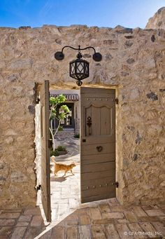 Garden doors in a rustic stone wall. Southwestern or Tuscan Entry Gates, Tuscan, Tuscan Style, Exterior Design, Stone Houses, Beautiful Doors, Rustic Stone, Mediterranean Home Decor, Tuscan Style Homes