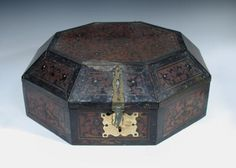 Sale F170615 Lot 968  A Continental marquetry inlaid ebony and hardwood octagonal box, with floral marquetry decoration and brass strapwork hinges and clasp, the hinged cover with brass stay h:25 w:50 d:50 cm  - Cheffins