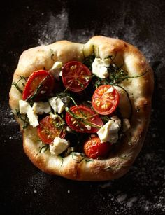pizza with tomatoes and goat cheese