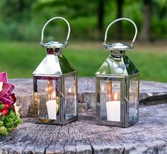 Effortlessly create a mood of romance and light the way for your guests with this versatile Stainless Lantern with Glass Panels. The lantern's chic glass paneling makes it the perfect accent piece for Outdoor Candle Lanterns, Lantern Centerpiece Wedding, Succulent Centerpieces, Wedding Lanterns, Wedding Centerpieces, Wedding Favors, Wedding Table, Wedding Ceremony, Wedding Groom