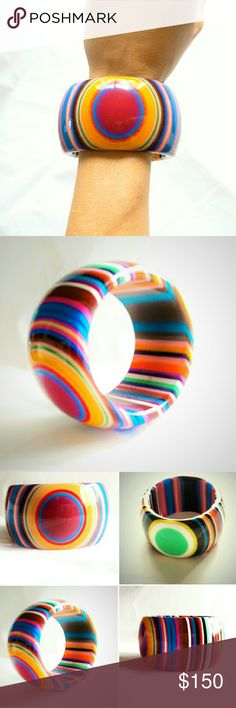 """Vintage Sobral HUGE Chunky Psychedelic Bangle Vintage Sobral HUGE Chunky Psychedelic Bangle Bracelet. This bangle has two eyes, one on each side, with different color bursts utilizing almost every color you can imagine. Quite a substantial piece measuring approximately 2"""" wide, and almost .5"""" thick, with a nice dome. The opening measures 2.5"""".? In excellent condition with minimal wear. Vintage Jewelry Bracelets"""
