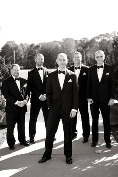 The groom and groomsmen looking dapper in their tuxedos at this traditional and elegant wedding.