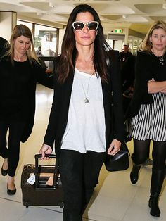Just in time for Independence Day, Sandra Bullock leaves chilly Sydney on Tuesday after debuting her new film, The Heat, Down Under.