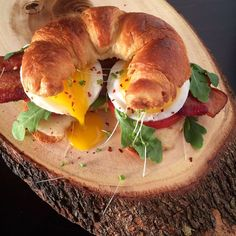 Sunday's sandwich started as a BLT but ended up a BELT. A toasted croissant with melted extra-old cheddar cheese, vine ripened tomatoes, baby arugula, thick cut bacon, runny eggs, pepper flakes and roquette shoots. Enjoy the day everyone!!! @zimmysnook
