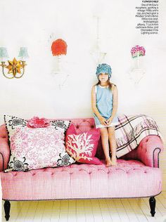 Oh my word!  I LOVE this pink couch!  If only I had my own craft room, I would SO deck it out in fun colours!