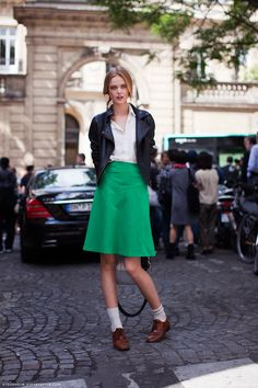 Green A-line skirt, leather jacket, white button-up and brown Oxford shoes.