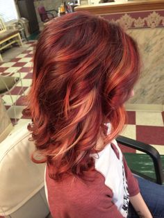 Violet/Bright red ombré with blonde peek boo highlights.