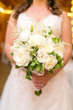 Beautiful bridal bouquet of ivory roses, lisianthus, and astilbe mixed with pittosporum and bupleurum. {Amy Allen Photography}