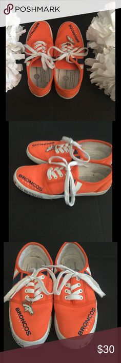 Denver Broncos tennis shoes Bradford Exchange tennis shoes featuring the Denver broncos! Vibrant orange color with blue and white stripes.  It says I ❤ the Broncos on front on both shoes.  The back has the Bradford Exchange on it.  The size is 6 1/2.  The right shoe has the horse head on the shoestring like a charm.  Minimal scuffing.  I wore a few times but they are too small for my feet!  Need to go to a Broncos lovers home! Shoes Sneakers