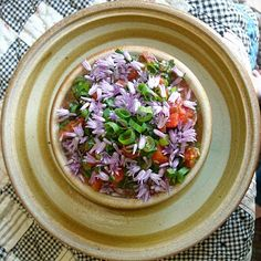 Tomato salsa with garden herbs - oregano, green onion, garlic tops and chive flowers.