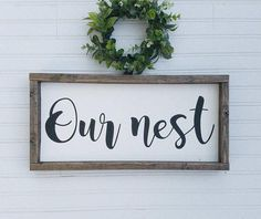Our nest framed wood sign. Perfect to add to your rustic farm house style entry way, living room or gallery wall!  This sign pictures has an antique white background with black words, the frame is stained espresso. The back is painted white. Choose your lettering and stain options from the drop down menu.  This framed wooden rustic sign is 9.5x19.5 (including the frame). It is made with NEW wood, its common for the board to have knots or show grain, no attempt is made to cover the…