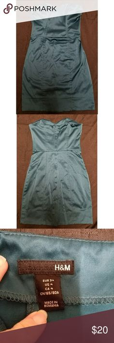 """H&M Satin Teal Pencil Dress Size 4 Women's H&M teal satin strapless pencil dress, size 4. It has light boning on the front and sides of the torso and a zipper up the back. It is in excellent used condition with no stains, tears, rips or holes that I can see.   50% polyester/47% cotton/3% elastane   Armpit to armpit: 13.5"""" Chest: 27"""" Waist: 24"""" Length (armpit to hem): 24""""  All items come from a smoke and pet free home. H&M Dresses Strapless"""