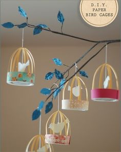 paper bird cages: maybe for centerpieces or hanging from branches of trees @ venue site?