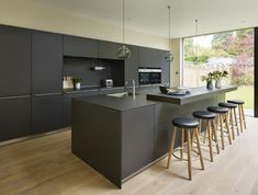 Kitchen Architecture bulthaup - A view to extend Open Kitchen And Living Room, New Kitchen, Kitchen Decor, Kitchen Cabinets And Countertops, Kitchen Flooring, Kitchens And Bedrooms, Home Kitchens, Black Kitchen Island, Kitchen Bar Design