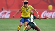 Sweden's defender Elin Rubensson (L) vies for the ball with Nigeria's forward Ngozi Okobi during Group D match of the 2015 FIFA Women's World Cup between Nigeria and Sweden at the Winnipeg Stadium on June 8, 2015, in Winnipeg, Manitoba. AFP PHOTO/JEWEL SAMAD